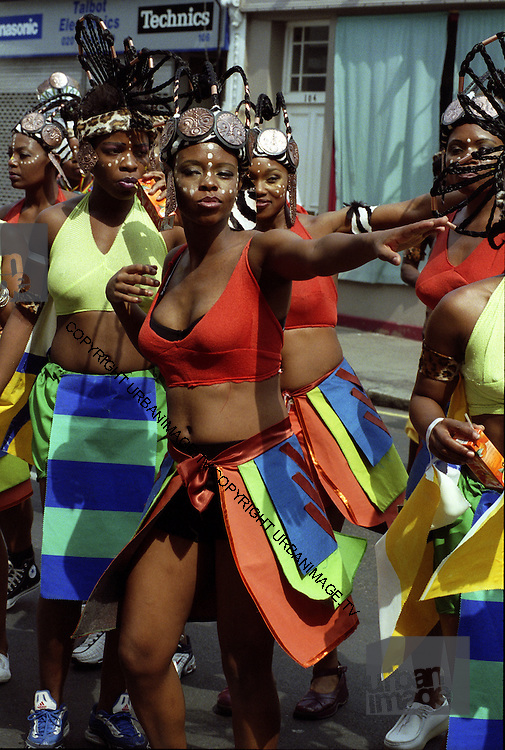 Girls Revelers and dancers at Londons Notting Hill Carnival parade 2014