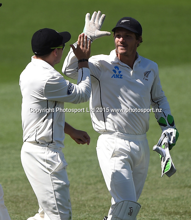 Tom Latham celebrates with BJ Watling after taking a catch at 3rd slip to dismiss Mathews on day 2 of the 2nd cricket test match between New Zealand Black Caps and Sri Lanka at Seddon Park in Hamilton, New Zealand. Saturday 19 December 2015. Copyright photo: Andrew Cornaga / www.photosport.nz