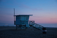 Photo Santa Monica Beach Sunset wall art. Pink sky, lifeguard station, pier, ocean waves, blue sky. Matted print, Westside, Venice, Los Angeles, Southern California photography. Fine art photography limited edition.