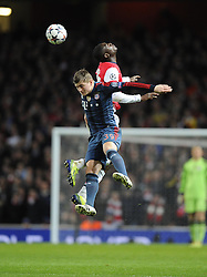 Arsenal's Yaya Sanogo battles for the high ball with Bayern Munich's Toni Kroos - Photo mandatory by-line: Joe Meredith/JMP - Tel: Mobile: 07966 386802 19/02/2014 - SPORT - FOOTBALL - London - Emirates Stadium - Arsenal v Bayern Munich - Champions League - Last 16 - First Leg
