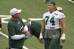 June 12, 2012; Florham Park, NJ, USA; New York Jets head coach Rex Ryan speaks with New York Jets center Nick Mangold (74) during New York Jets Minicamp at the Atlantic Health Training Center.