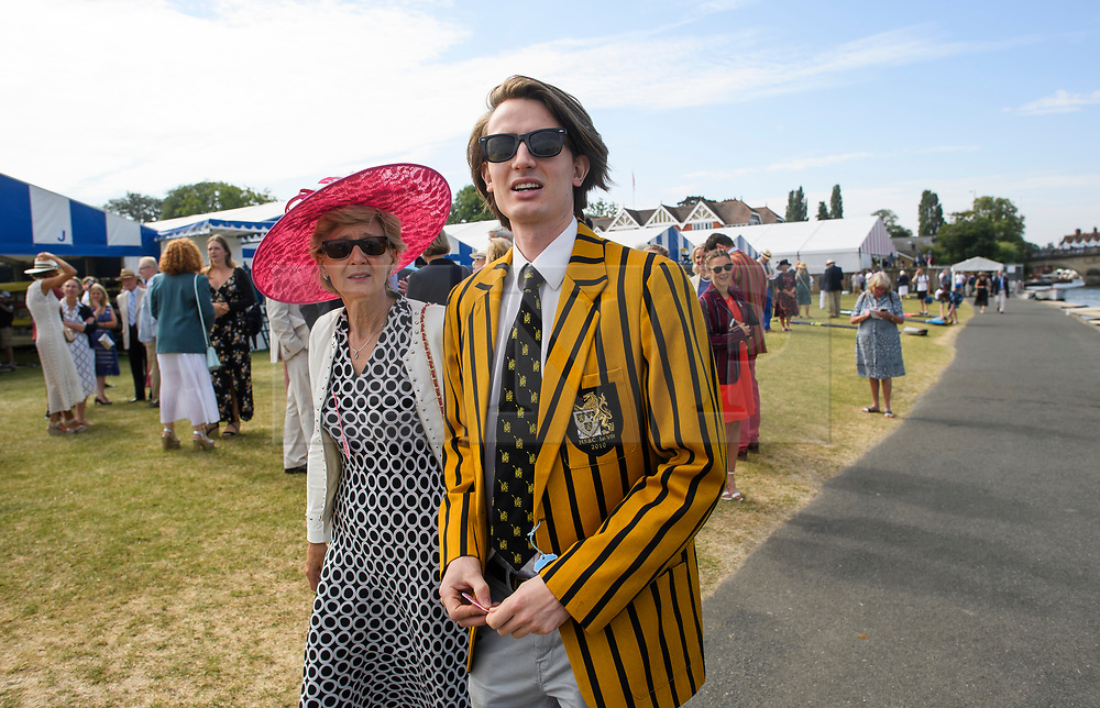 © Licensed to London News Pictures. 04/07/2018. Henley-on-Thames, UK. A man in rowing club colours attends day one of the Henley Royal Regatta, set on the River Thames by the town of Henley-on-Thames in England. Established in 1839, the five day international rowing event, raced over a course of 2,112 meters (1 mile 550 yards), is considered an important part of the English social season. Photo credit: Ben Cawthra/LNP