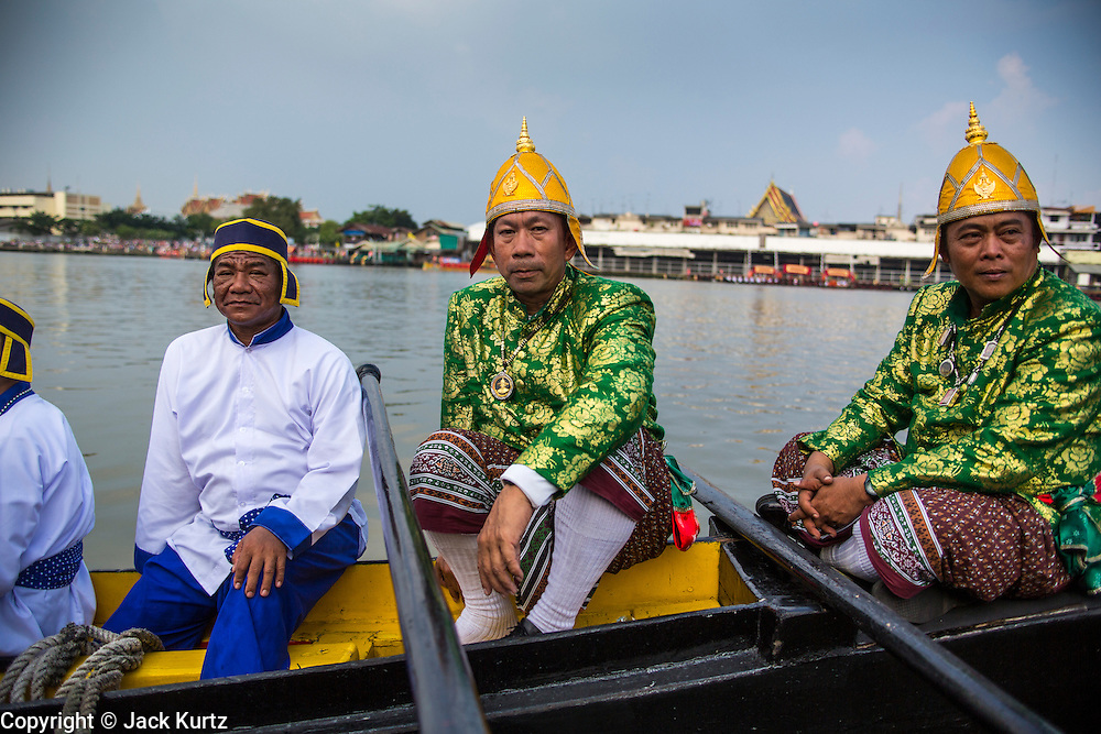 06 NOVEMBER 2012 - BANGKOK, THAILAND:  Steersmen and oarsmen relax on Royal Barge at the barge landing at Wat Arun after the final dress rehearsal for the Royal Barge Procession. Thailand's Royal Barge Procession has both religious and royal significance. The tradition is nearly 700 years old. The Royal Barge Procession takes place rarely, typically coinciding with only the most important cultural and religious events. During the reign of King Bhumibol Adulyadej, spanning over 60 years, the Procession has only occurred 16 times. The Royal Barge Procession consists of 52 barges: 51 historical Barges, and the Royal Barge, the Narai Song Suban, which King Rama IX built in 1994. It is the only Barge built during King Bhumibol's reign. These barges are manned by 2,082 oarsmen. The Procession proceeds down the Chao Phraya River, from the Wasukri Royal Landing Place in Bangkok, passes the Grand Palace complex and ends at Wat Arun. Tuesday's dress rehearsal was the final practice for the 2012 Royal Barge Procession, which takes place November 9.     PHOTO BY JACK KURTZ