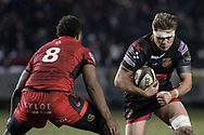 Lewis Evans of the Dragons runs at Edinburghs' Bill Mata.<br /> <br /> Photographer Simon Latham/Replay Images<br /> <br /> Guinness PRO14 - Dragons v Edinburgh - Friday 23rd February 2018 - Eugene Cross Park - Ebbw Vale<br /> <br /> World Copyright &copy; Replay Images . All rights reserved. info@replayimages.co.uk - http://replayimages.co.uk