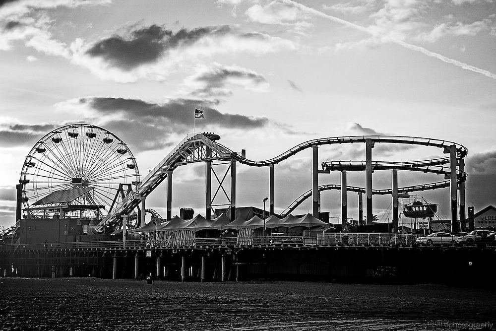 Santa Monica Pier and Pacific Park amusement park as seen in the late afternoon/early evening light.