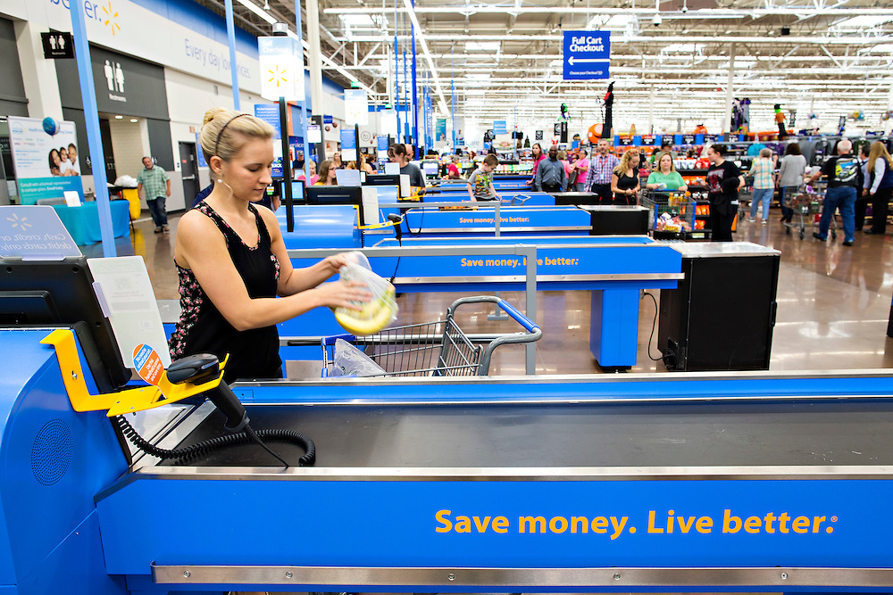 ROGERS, AR - OCTOBER 12:  Customer Dana Pendergraft checks out  at Walmart Store #4208 on October 12, 2015 in Rogers, Arkansas.  <br /> CREDIT Wesley Hitt for Wall Street Journal<br /> WALSQUEEZE