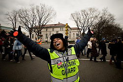 Mariama, a jubilent volunteer street crossing guard welcomes people to Washington DC January 18, 2009, ahead of the inauguration of Barack Obama as the 44th President of the United States of America . The electric and emotional mood was contagious as Obama became the first African-American to be elected to the office of President in the history of the United States. .
