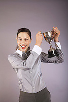 Businesswoman holding trophy portrait