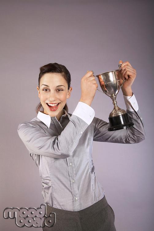 Businesswoman holding trophy portrait