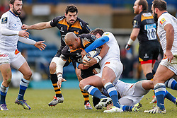 Wasps Winger Tom Varndell is tackled by Castres Olympique Hooker Marc-Antoine Rallier - Photo mandatory by-line: Rogan Thomson/JMP - 07966 386802 - 14/12/2014 - SPORT - RUGBY UNION - High Wycombe, England - Adams Park Stadium - Wasps v Castres Olympique - European Rugby Champions Cup Pool 2.