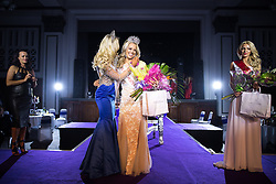 © Licensed to London News Pictures . 06/05/2016 . Manchester , UK . Miss Manchester winner GABIELLE TAYLOR (centre r) is crowned by last year's winner JODI EYRE (centre l) . Mr and Miss Manchester contest at the Palace Hotel in Manchester . Photo credit : Joel Goodman/LNP