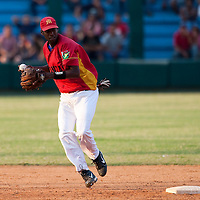 15 February 2009: Yadil Mujica of the Occidentales throws the ball to first base during a training game of Cuba Baseball Team for the World Baseball Classic 2009. The national team is pitted against itself, divided in two teams called the Occidentales and the Orientales. The Orientales win 12-8, at the Latinoamericano stadium, in la Habana, Cuba.
