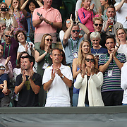 LONDON, ENGLAND - JULY 16: Supporters of Martina Hingis of Switzerland and Jamie Murray of Great Britain in the family box during the Mixed Doubles Final on Center Court during the Wimbledon Lawn Tennis Championships at the All England Lawn Tennis and Croquet Club at Wimbledon on July 16, 2017 in London, England. (Photo by Tim Clayton/Corbis via Getty Images)