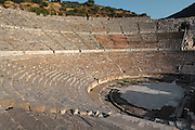 Great Theatre, built 3rd century BC and rebuilt in the Roman period, Panayir Hill, Ephesus, Izmir, Turkey. The theatre seats 25,000 and is believed to be the largest outdoor theatre in the ancient world. The cavea has 66 rows of seats, divided by 2 diazoma or walkways into 3 horizontal sections. The stage building is 3 storeys and 18m high. The facade facing the audience was ornamented with reliefs, columns with niches, windows and statues. Ephesus was an ancient Greek city founded in the 10th century BC, and later a major Roman city, on the Ionian coast near present day Selcuk. Picture by Manuel Cohen