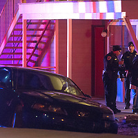 Gallup Police Officers take a suspect in to custody after performing a field sobriety test at the scene of an accident where the driver drove off the road near Cliffside Apartments Wednesday night.