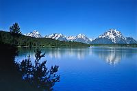 Reflections of Mount Moran and the Teton Range in Jackson Lake.  Grand Teton National Park.  Wyoming, USA