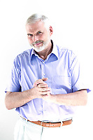 caucasian senior man portrait mischievous isolated studio on white background