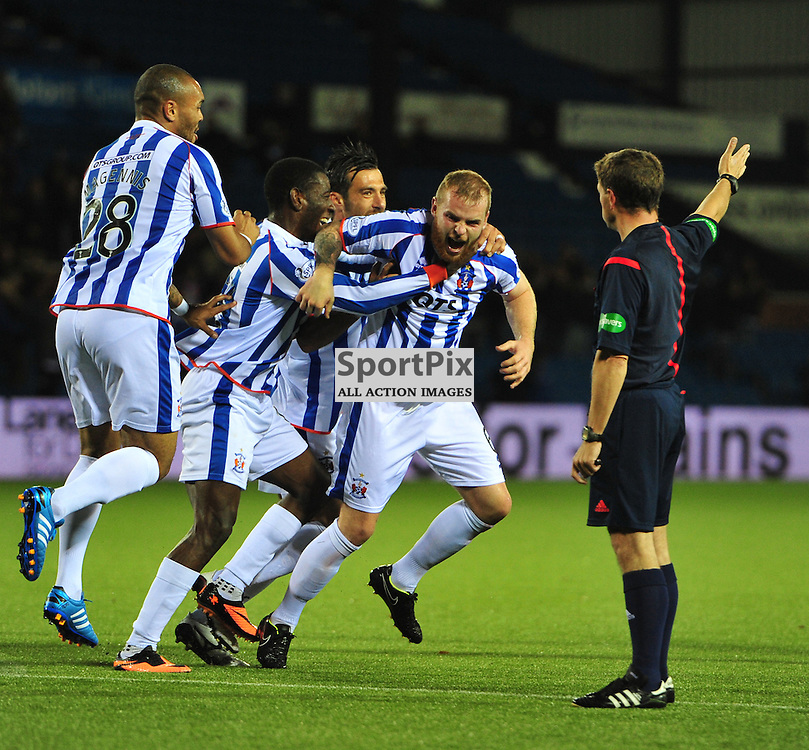 Mark Connolly is mobbed as he runs to celebrate his goal against United (c) BILLY WHITE | SportPix.org.uk