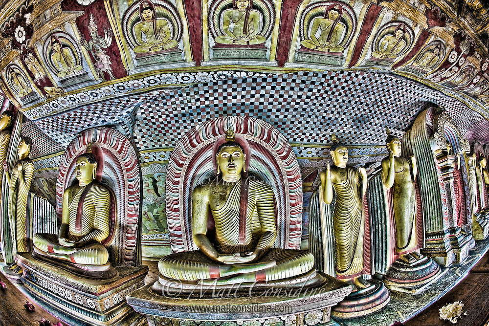 Colorful Buddhas located inside a cave temple.<br /> (Photo by Matt Considine - Images of Asia Collection)