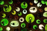 Wine bottles in stucco wall, Champagne Creek Cellars, Oregon