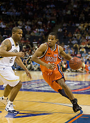 Virginia guard Sean Singletary (44) dribbles past Georgia Tech guard Maurice Miller (3).  The Virginia Cavaliers fell to the Georgia Tech Yellow Jackets 94-76  in the first round of the 2008 ACC Men's Basketball Tournament at the Charlotte Bobcats Arena in Charlotte, NC on March 13, 2008.