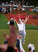 "Adam Scott celebrates after making a putt on hole No. 10 to win The Masters Sunday at Augusta National Golf Club in Augusta, Georgia. Scott defeated Angel Cabrera in a playoff. ""Masters Champ"""