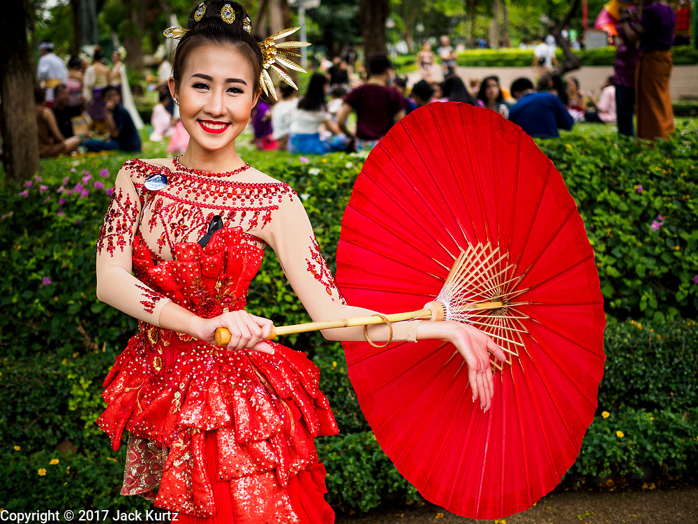 "08 APRIL 2017 - BANGKOK, THAILAND: Entertainers at the ""Amazing Songkran"" festival in Benchasiri Park in Bangkok. The festival was sponsored by the Tourism Authority of Thailand to highlight the cultural aspects of Songkran. Songkran is celebrated in Thailand as the traditional New Year's Day from 13 to 16 April. Songkran is in the hottest time of the year in Thailand, at the end of the dry season and provides an excuse for people to cool off in friendly water fights that take place throughout the country. Songkran has been a national holiday since 1940, when Thailand moved the first day of the year to January 1. Songkran 2017 is expected to be more subdued than Songkran usually is because Thais are still mourning the October 2016 death of revered King Bhumibol Adulyadej.       PHOTO BY JACK KURTZ"