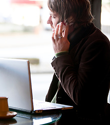 Man using cell phone in a cafe