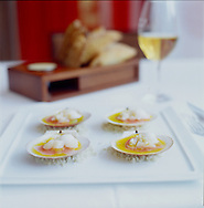 Toqué! Restaurant in Montreal.  Pictured here are Marinated scallops, daikon, apple water and wasabi mousse