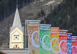 17.03.2017, Ramsau am Dachstein, AUT, Special Olympics 2017, Wintergames, Langlauf, Divisioning 5 km Freestyle, im Bild Fahnen mit dem Logo von Special Olympics und der Turm der evangelischen Kirche // flags and the church of Ramsau during the Cross Country Divisioning 5 km Freestyle at the Special Olympics World Winter Games Austria 2017 in Ramsau am Dachstein, Austria on 2017/03/17. EXPA Pictures © 2017, PhotoCredit: EXPA / Martin Huber