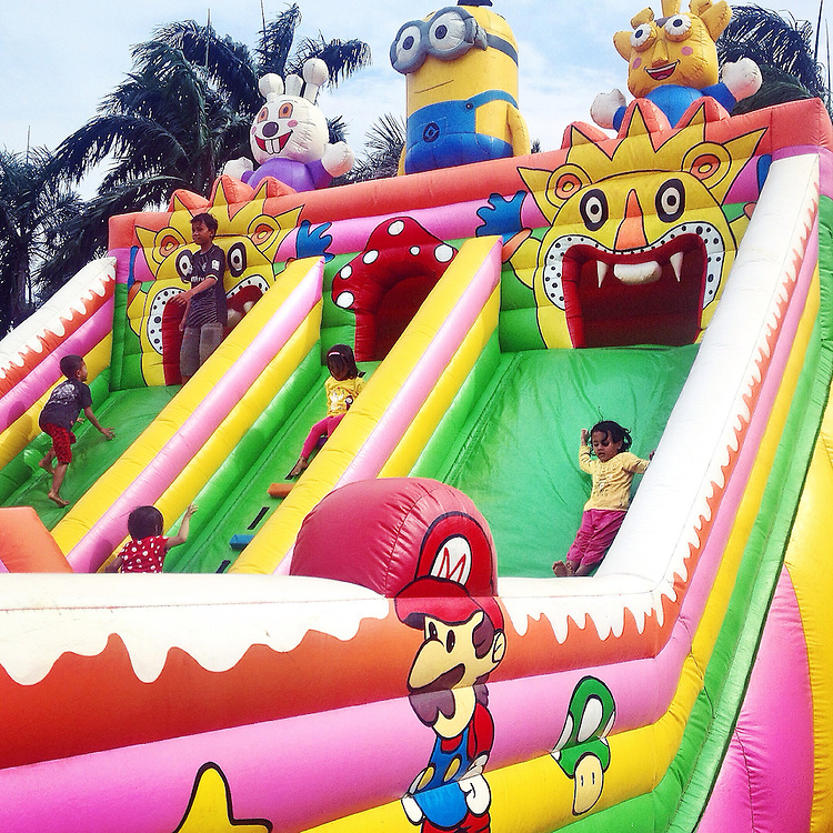 Children playing inside a bouncy castle at Monas Square.