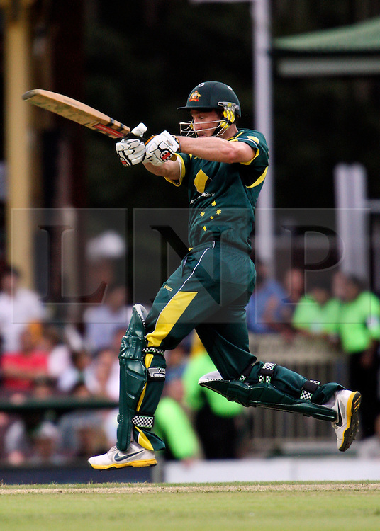 © Licensed to London News Pictures. 17/02/2012. Sydney Cricket Ground, Australia. David Hussey jumps & plays an athletic pull shot during the One Day International cricket match between Australia Vs Sri Lanka. Photo credit : Asanka Brendon Ratnayake/LNP