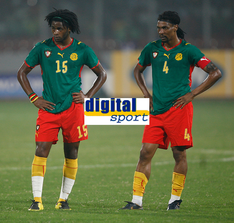 Photo: Steve Bond/Richard Lane Photography.<br /> Egypt v Cameroun. Africa Cup of Nations. 22/01/2008. Cameroon players Alexandre Song (L) of Arsenal  and Rigobert Song (R) of Galatasary contemplate a heavy defeat
