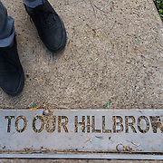 """""""Welcome to our Hillbrow"""" is seen across a footpath leading to a park in Hillbrow, an inner-city neighbourhood in Johannesburg, South Africa with a reputation for drugs, crime and violence. Though it has a slide, swings and other play equipment for children, the park is the domain drug dealers and their clients."""