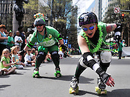 2012: Everyday Life. Members of the Charlotte Roller Girls roller skate on N. Tryon St. during the annual St. Patrick's Day parade in Uptown Charlotte on Saturday, March 17, 2012.<br />