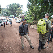 A group of hikers finish their descent of Mt Kilimanjaro by arriving at Mweka Gate (5,500 feet).
