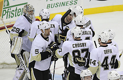 Mar 17; Newark, NJ, USA; Pittsburgh Penguins center Sidney Crosby (87) and the Pittsburgh Penguins celebrate their 5-2 win over the New Jersey Devils at the Prudential Center.