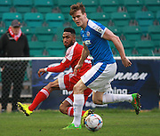 Dover defender Sean Raggett & Whitehawk defender Craig Braham-Barrett during the FA Trophy match between Whitehawk FC and Dover Athletic at the Enclosed Ground, Whitehawk, United Kingdom on 12 December 2015. Photo by Bennett Dean.