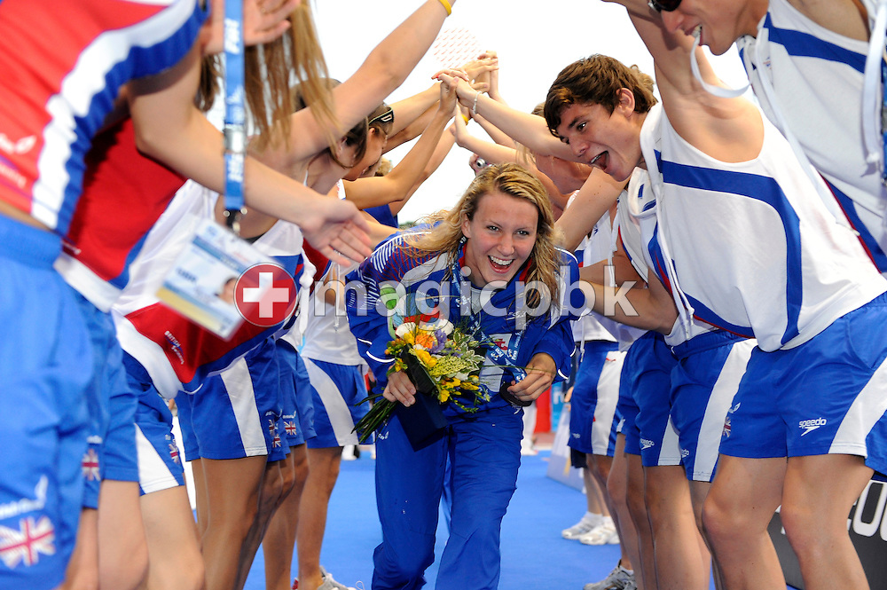 Jazmin Carlin of Great Britain runs trough a tunnel of honour made by her teammates after finishing third in the women's 4x200m freestyle relay final at the 13th FINA World Championships at the Foro Italico complex in Rome, Italy, Thursday, July 30, 2009. (Photo by Patrick B. Kraemer / MAGICPBK)