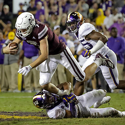 Oct 20, 2018; Baton Rouge, LA, USA; LSU Tigers safety Grant Delpit (9) sacks Mississippi State Bulldogs quarterback Nick Fitzgerald (7) during the second half at Tiger Stadium. LSU defeated Mississippi State 19-3. Mandatory Credit: Derick E. Hingle-USA TODAY Sports