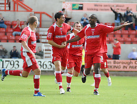 Photo: Ed Godden.<br />Swindon Town v Stockport County. Coca Cola League 2. 26/08/2006. Aaron Brown (far right) celebrates his goal with his Swindon team mates).
