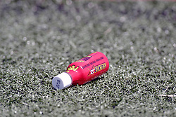 12 August 2006:  a bottle of energy supplement lies on the sidelines of a football field. This image was produced in part utilizing High Dynamic Range (HDR) or panoramic stitching or other computer software manipulation processes. It should not be used editorially without being listed as an illustration or with a disclaimer. It may or may not be an accurate representation of the scene as originally photographed and the finished image is the creation of the photographer.
