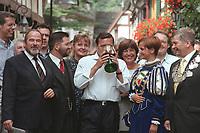 """16 JUL 1999 - UNKEL, GERMANY:<br /> Gerhard Schröder, Bundeskanzler, kostet den Wein der Stadt Unkel aus dem Glas der Weinkönigin, während der SPD Radtour """"Abschied vom Rhein""""<br /> Gerhard Schroeder, Fed. Chancellor Germany, is drinking the wine from the city of Unkel from the glas of the wine-queen of Unkel, during a trip with a part of the SPD parliamentary group to a """"Goodbye from Rhine"""" tour <br /> IMAGE: 19990716-01/09-09<br /> KEYWORDS: Alkohol, alcohol"""