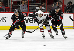 March 3, 2017 - Raleigh, NC, USA - The Canes Jeff Skinner (53) and Derek Ryan (33) battle the Arizona Coyotes' Tobias Rieder (8) for the puck during the second period of an NHL game played between the Carolina Hurricanes and the Arizona Coyotes at PNC Arena on March 3, 2017 in Raleigh, N.C. (Credit Image: © Chris Seward/TNS via ZUMA Wire)