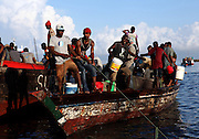 Fishermen bring in the day's catch in Stone Town in Zanzibar, Tanzania.