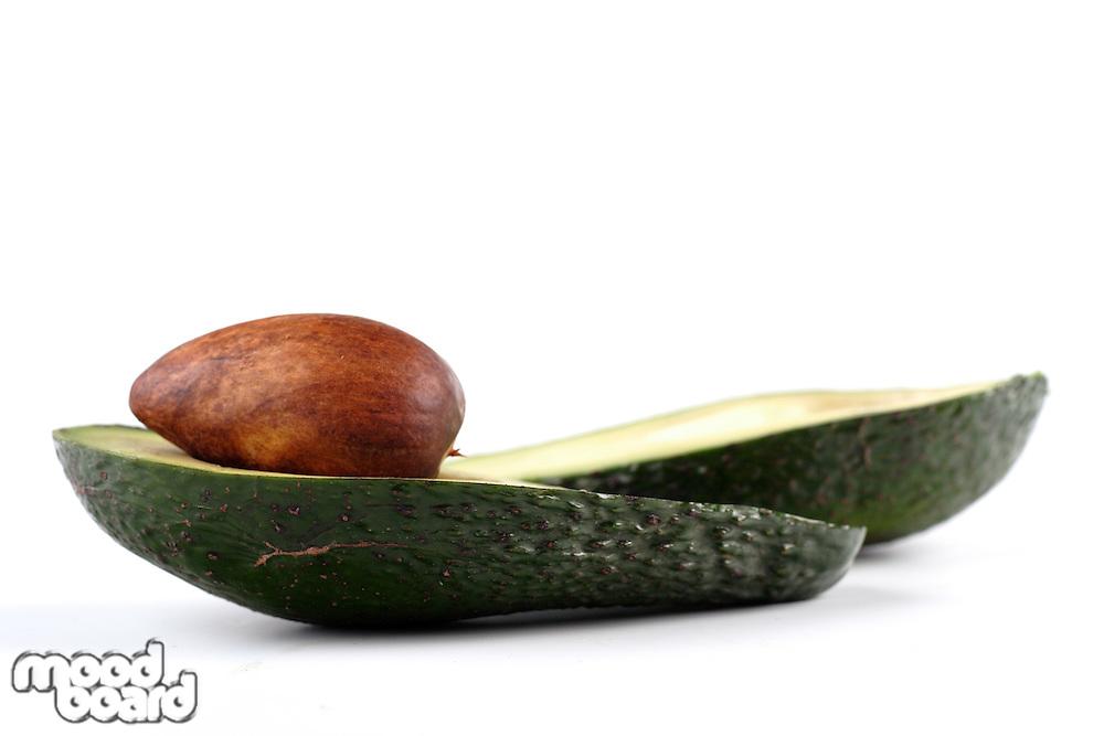 Studio shot of avocados on white background