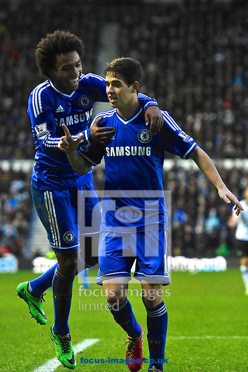 Picture by Ian Wadkins/Focus Images Ltd +44 7877 568959<br /> 05/01/2014<br /> Oscar of Chelsea (right) celebrates after scoring to make it 2-0 during the The FA Cup match at the Ipro Stadium, Derby.