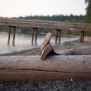 Feet up on a beach on Orcas Island in the San Juan Islands in Washington.