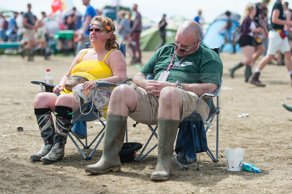 © Licensed to London News Pictures. 27/06/2015. Pilton, UK.  Festival atmosphere at Glastonbury Festival 2015 on Saturday Day 4 of the festival.  This years headline acts include Kanye West, The Who and Florence and the Machine, the latter being upgraded in the bill to replace original headline act Foo Fighters. Photo credit: Richard Isaac/LNP