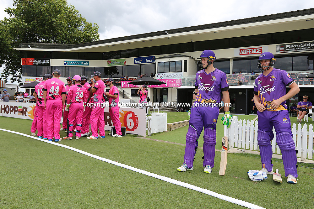 Nick Kwant (L) and Michael Pollard (R) prepare to open the Kings innings in the Burger King Super Smash Twenty20 cricket match Knights v Kings played at Seddon Park, Hamilton, New Zealand on Sunday 14 January 2018.<br /> <br /> Copyright photo: &copy; Bruce Lim / www.photosport.nz